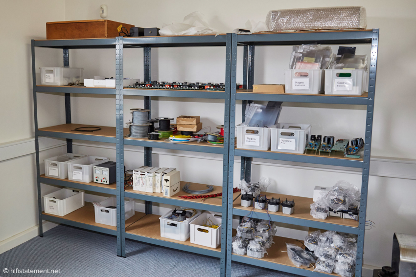 The shelves in Johnnie B.'s office are used for the storage of electronic components for pumps and motors
