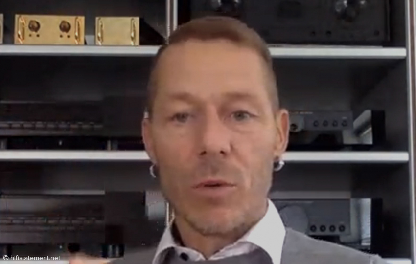 Rune Skov in front of a shelf with legendary components from Gryphon Audio Designs