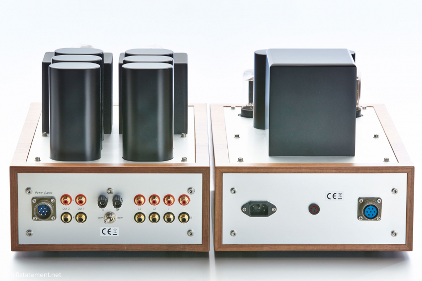 The huge power transformer on the right provides the plate voltage. Filament transformers are mounted inside. Sprague capacitors on the signal section on the left.