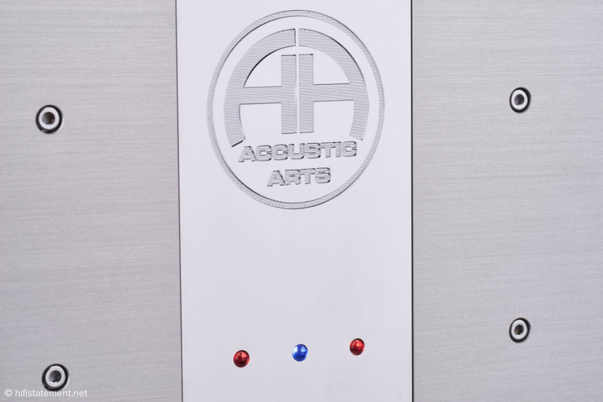 The front plate is made of solid aluminum and decorated with a chrome-plated brass inlay showing the company's logo