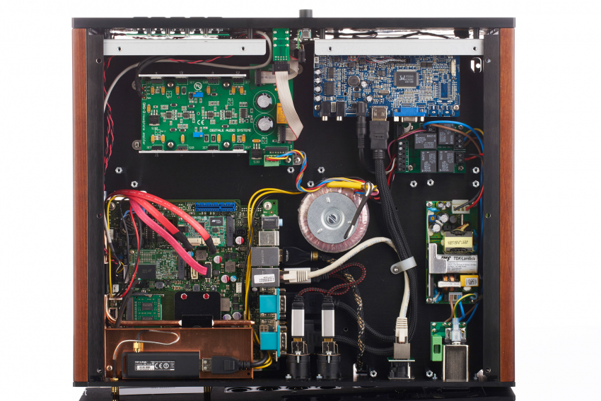 The basement floor: top left the headphone amplifier; below the mainboard of the server; bottom left the WLAN module shielded with copper; top right the video converter boards for the front displays