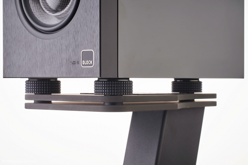 The stand's elaborate execution of the Shelf Block speakers' height adjustment